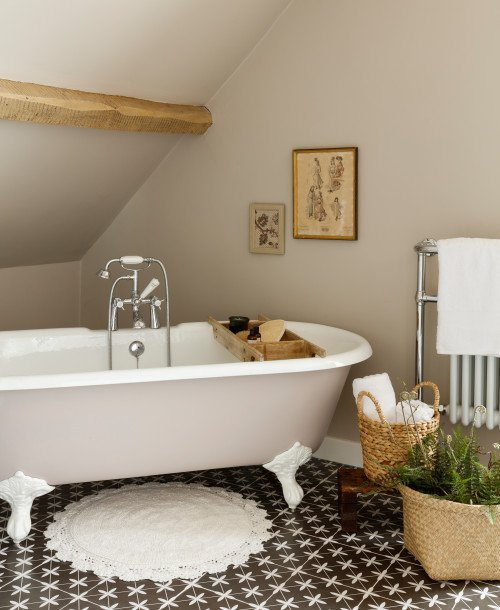 Farmhouse Bathroom with Brown and White Patterned Floor and Beamed Ceiling