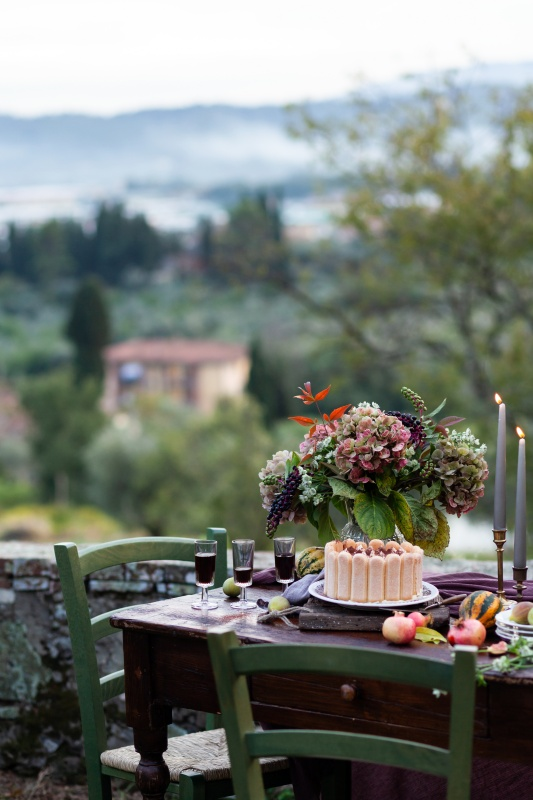 Outdoor Dining with Small Table and Fresh Flowers