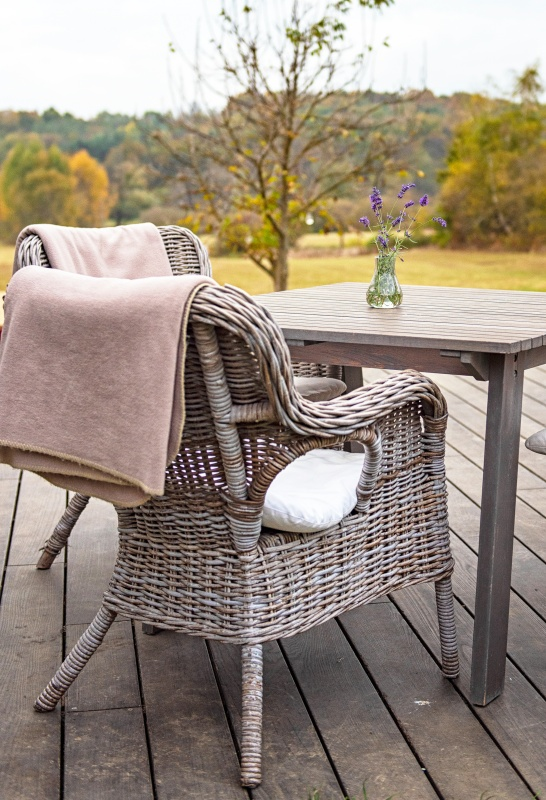 Wicker Chairs and Wood Table on Terrace