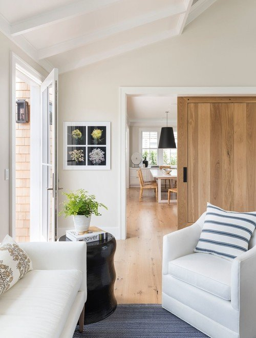 Beach Style Family Room with Light Wood Floors and White Walls