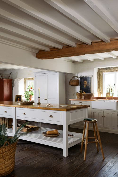 Expansive center island in country style kitchen