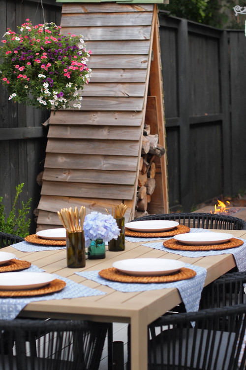 Outdoor Dining Table with Black Woven Chairs