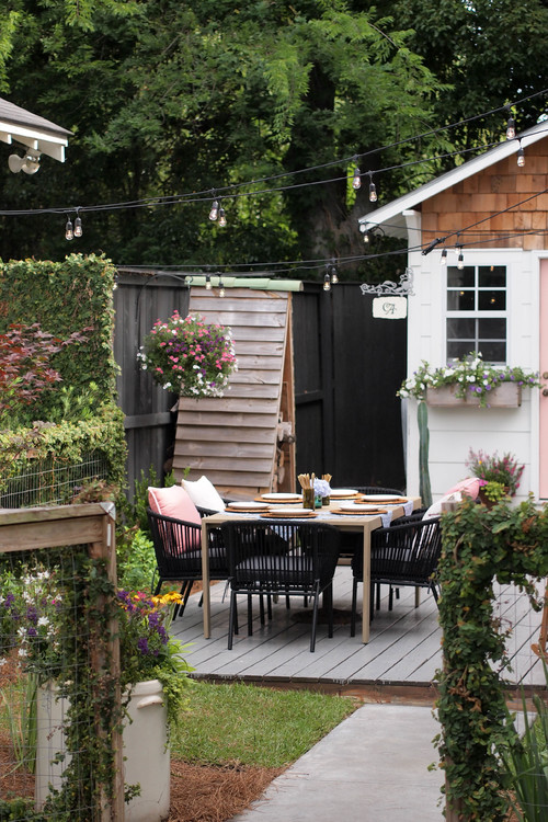 Adorable She Shed and Courtyard Deck with Dining Space