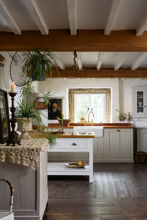 Country Style Old World Kitchen with Wood Floors and Large Center Island