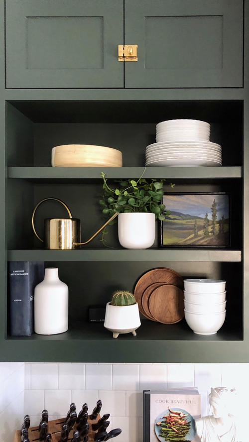 Styled Kitchen Shelves with White Dishes, Plants, and Small Landscape Painting