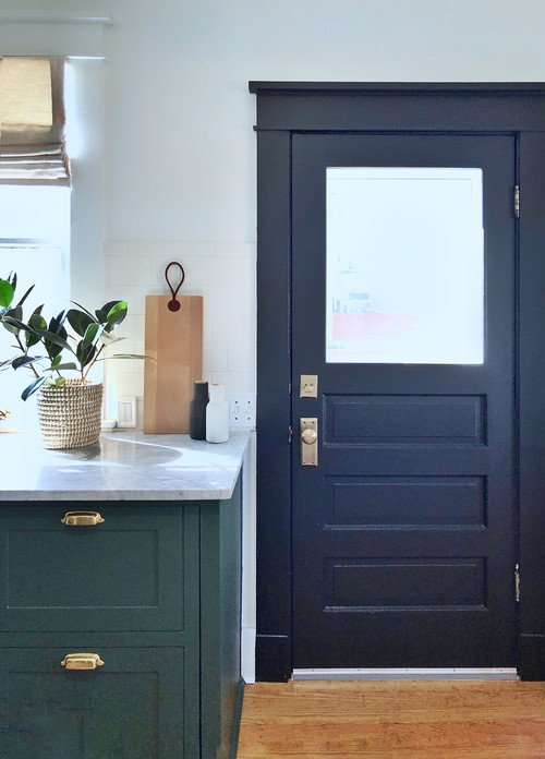 Black Door in Vintage Kitchen with Dark Green Cabinets