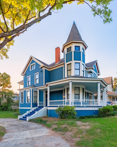 Blue Historic House with Turret and Wrap Around Porch
