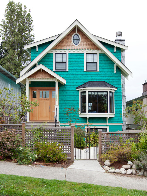 Aqua Victorian Style Cottage with Fish Scale Trim and Dental Molding