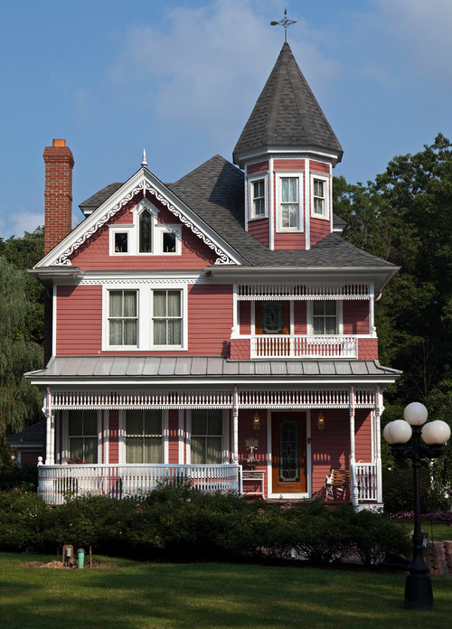 Red Victorian Farmhouse House with White Gingerbread Trim