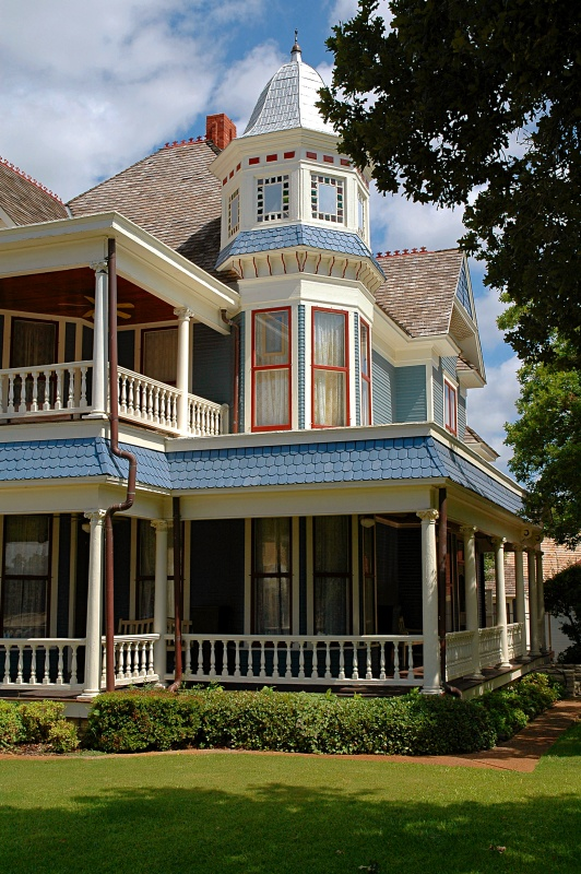 Blue Victorian House with Wrap Around Porch and Stunning Turret