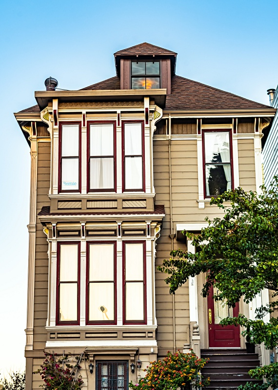 Charming Victorian style American home/ house/ townhouse/ duplex in San Francisco city, California. Front exterior view of a beautiful residence. Modern architecture with vintage design appeal.