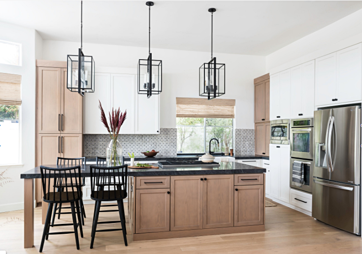Modern Farmhouse Kitchen with Light Wood Cabinets and Black Counter Tops