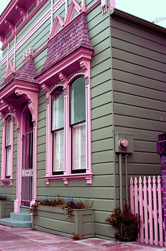 Pink Victorian Cottage in the City with Pink Picket Fence