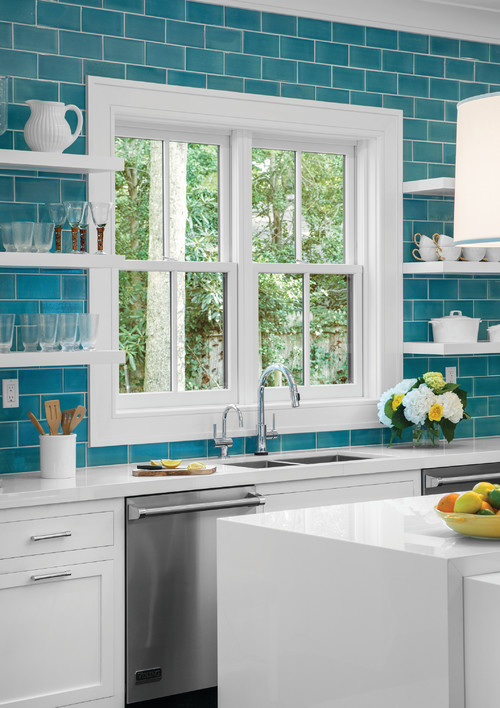 Turquoise kitchen subway tile with white trim