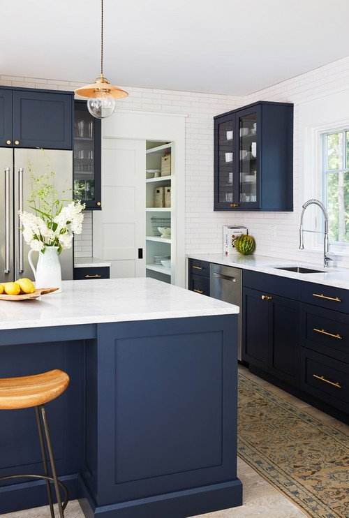 Navy Blue Kitchen Cabinets and White Counter Tops and Subway Tile