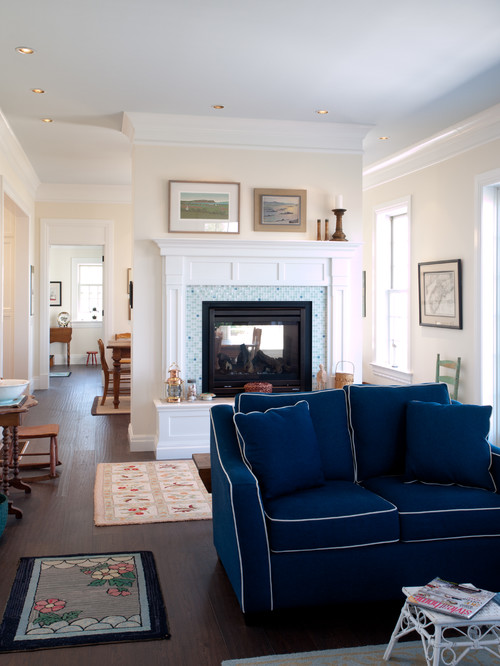 Historic home living room with double-sided fireplace