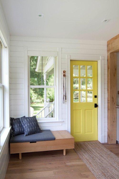 Scandinavian entryway into renovated farmhouse - yellow door