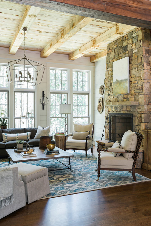 Natural Wood Beamed Ceiling in Living Room with Stone Fireplace