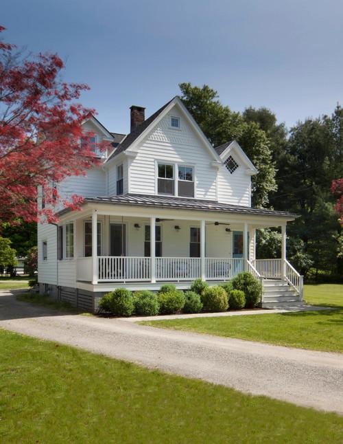 White Farmhouse with Wrap Around Porch