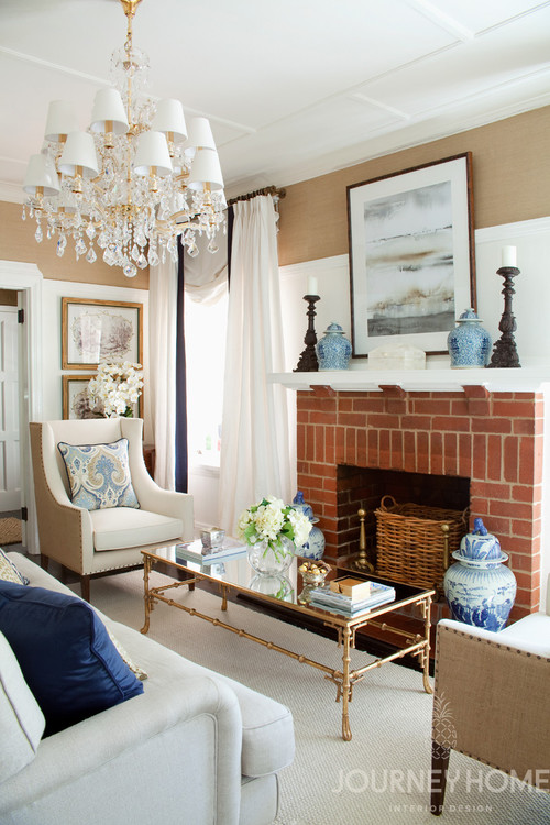 Traditional Living Room with Brick Fireplace and Blue and White Ginger Jars