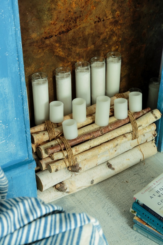 Birch Logs and Candles in a Faux Mantel