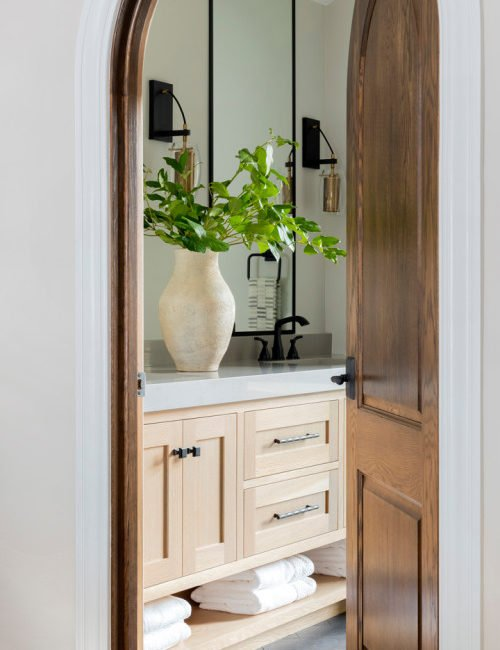 Modern Bathroom with Arched Wood Doorway
