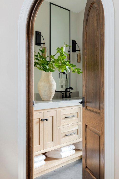 Modern Bathroom with Arched Wood Doorway