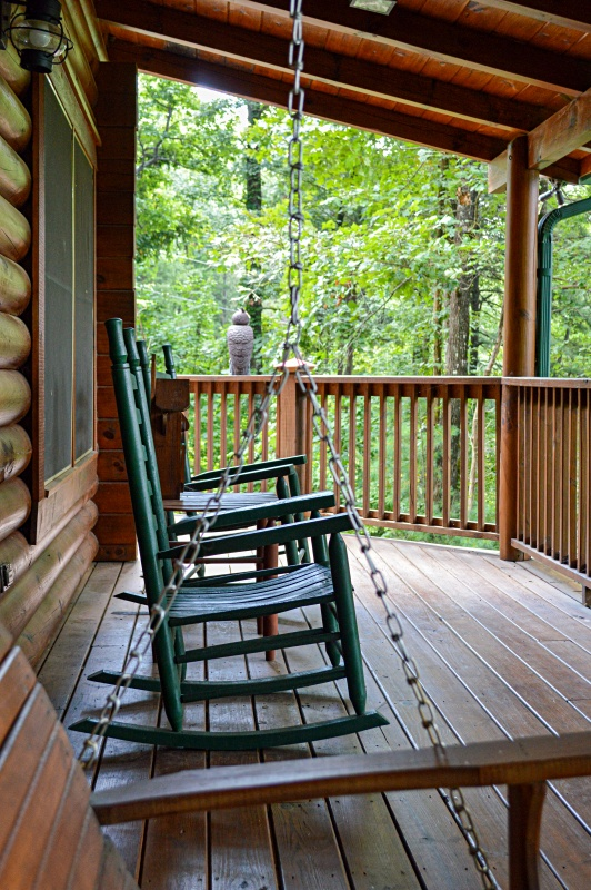 Cabin Porch with a Pair of Green Rockers