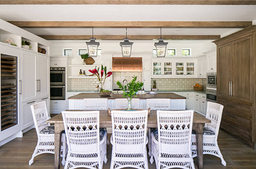 Eat In Kitchen with Wood Table and White Wicker Chairs