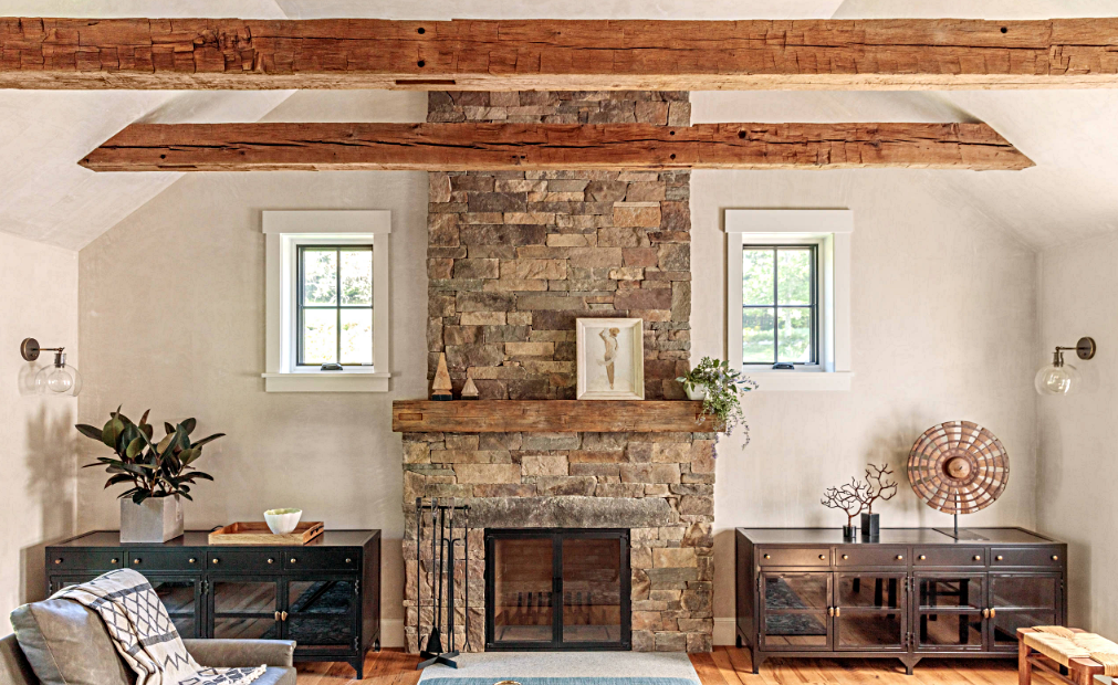 Rustic Family Room with Beamed Ceiling and Stone Fireplace