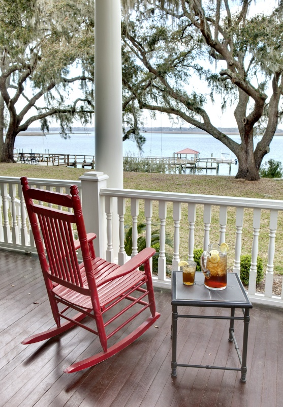 Red Rocking Chair on Porch by the Lake