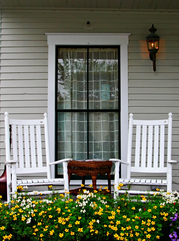 Pair of White Rockers on American Front Porch
