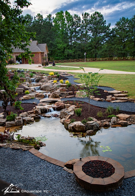 Pond and Waterfall with Firepit and Gravel Paths