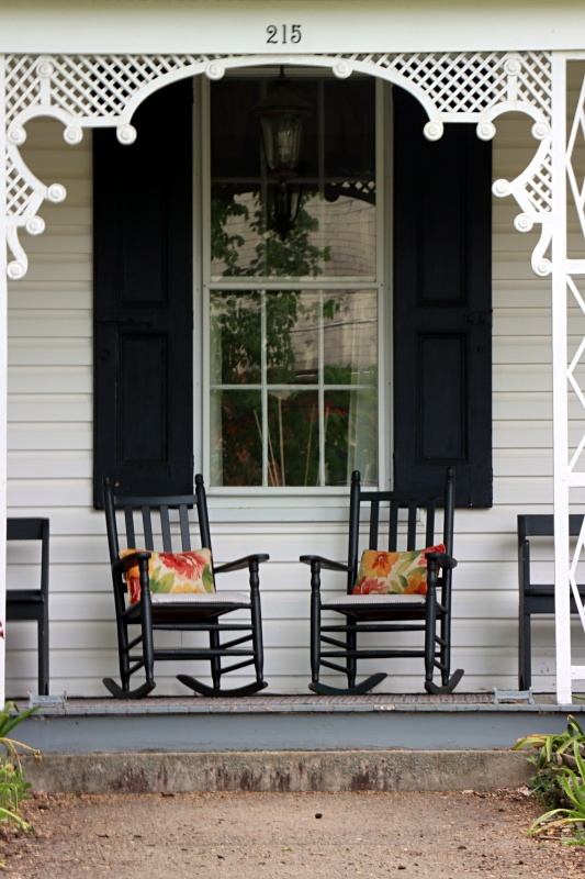 Victorian Porch with Black Rocking Chairs