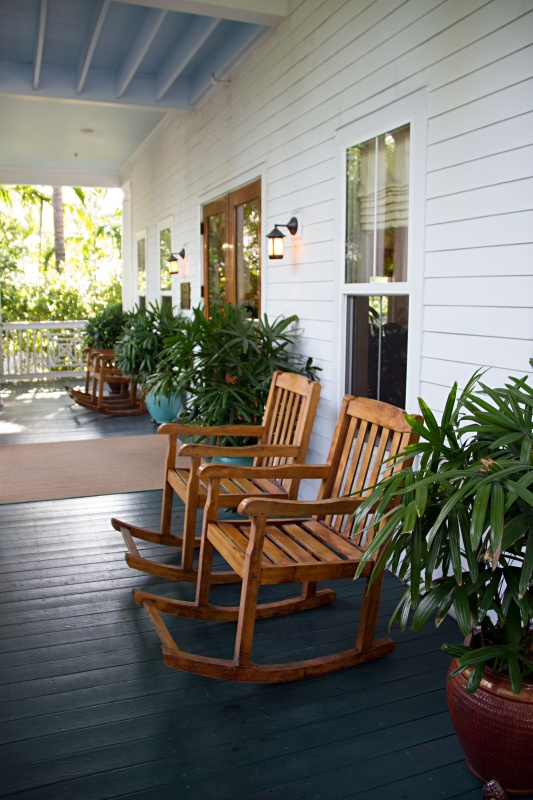 Pair of Wooden Rockers on Porch with Plants