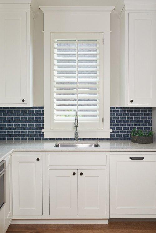 White Kitchen Cabinets with Blue Tile Back Splash