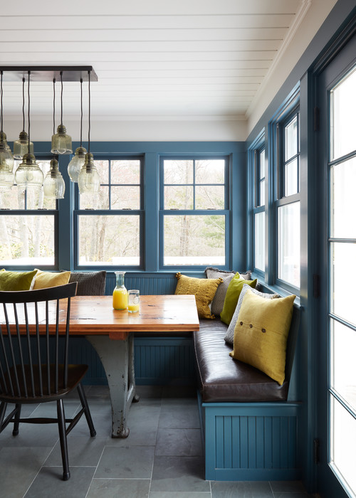 Breakfast nook with farmhouse table and banquette and Windsor chair seating