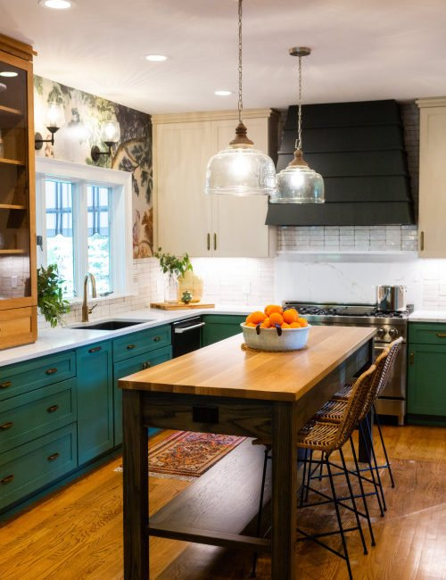 Eclectic Kitchen with Mixed Finishes and Green Cabinets