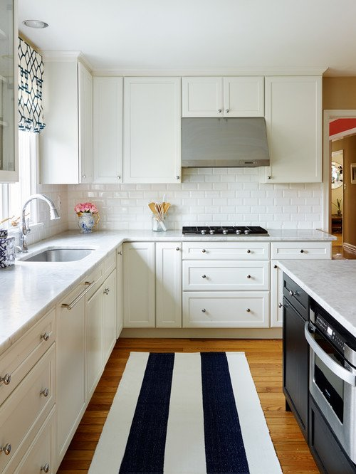 A bold kitchen rug in blue and white stripes