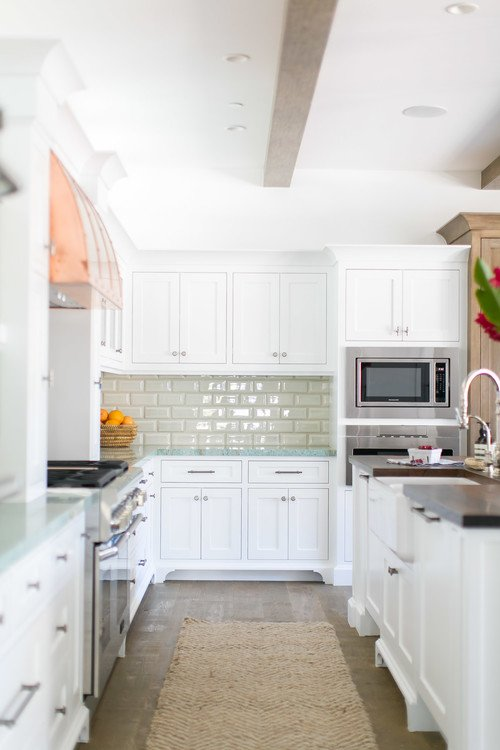 White Kitchen with Copper Stove Hood Vent