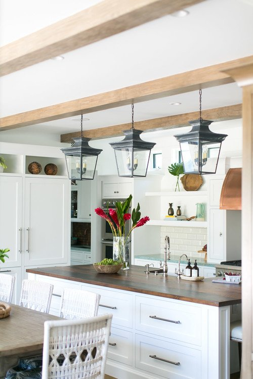 White and Wood Kitchen with Black Pendant Lights Over Island