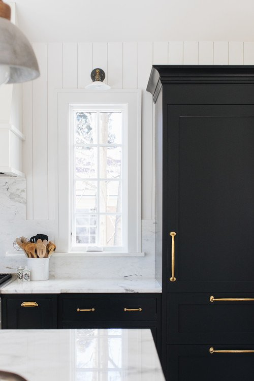Black Kitchen Cabinets and White Marble Counter Tops