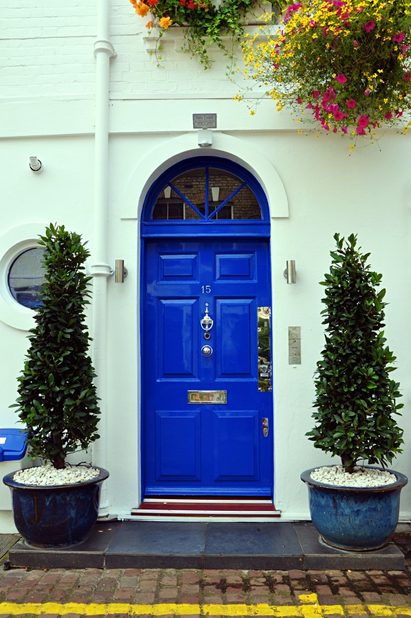Bright Blue Door with Arched Transom Window