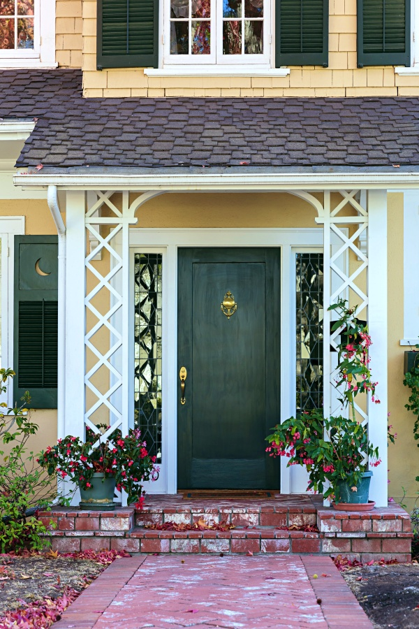 Green Front Door on Yellow Colonial Style Home