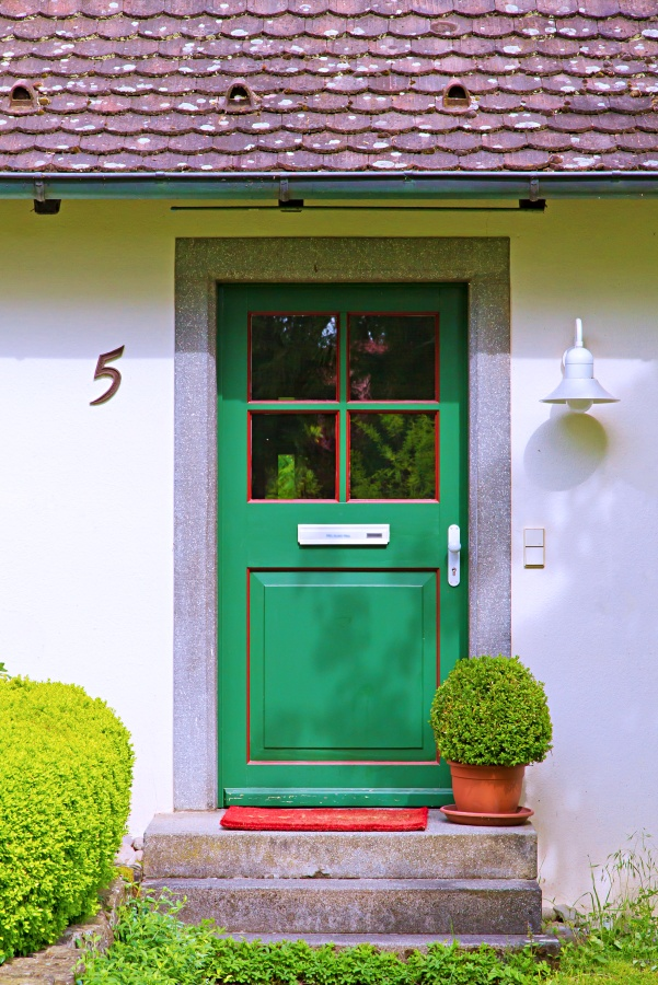 Green Windowed Exterior Door on a Quaint Cottage