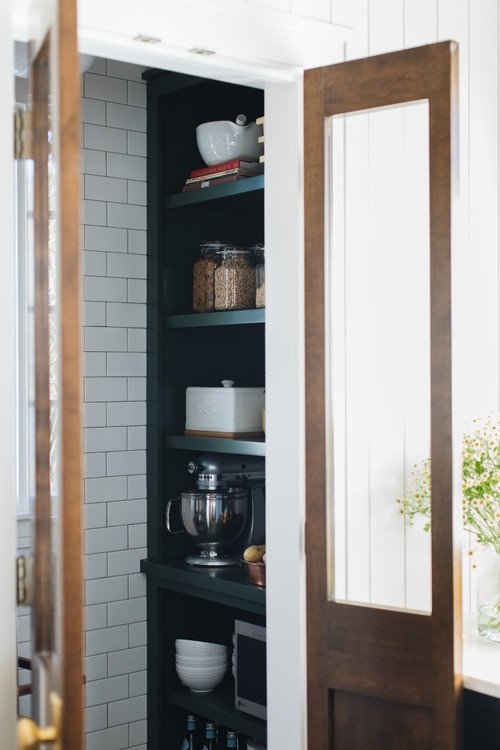 Kitchen Pantry with Double Wood Doors and Built In Shelves