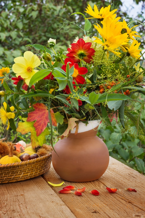 Haphazard Arrangement of Late Summer Flowers in Terra Cotta Vase
