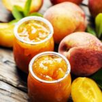Summer peach jam on the wooden table,
