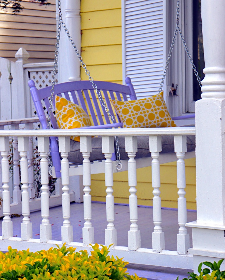 Porch Decor Purple Swing and Yellow Pillows