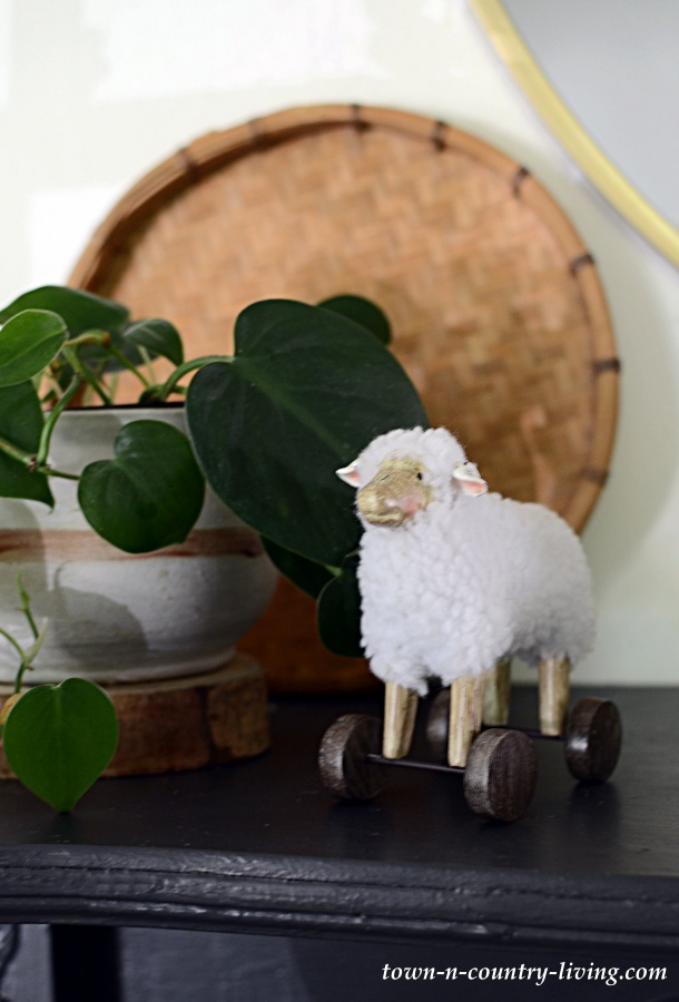 Child's Sheep Toy with Philodendron on Transitional Mantel